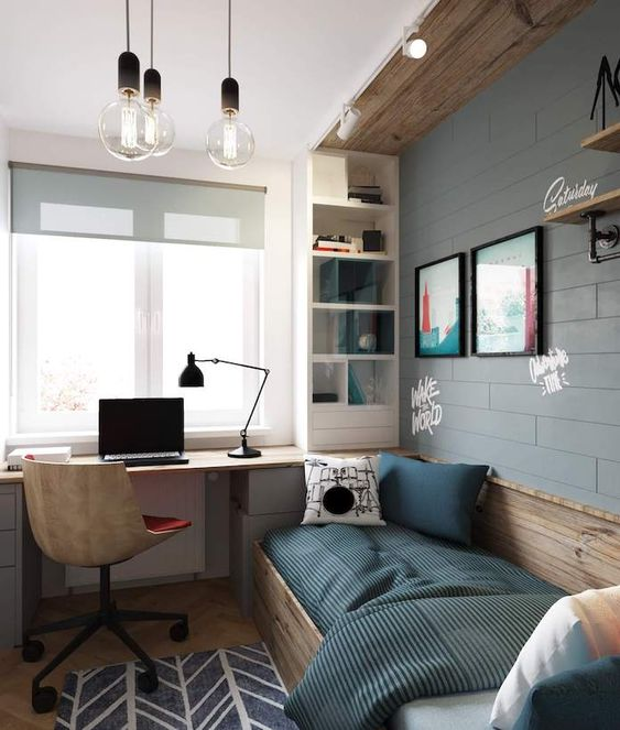 an industrial teen room with a faux brick wall, wooden touches, a bed, a built in desk and a storage shelf plus bulbs