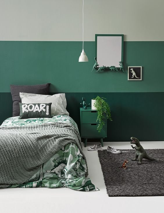 a fun mint and green dinosaur-themed room with greenery, dinos and fun bedding is perfectly styled