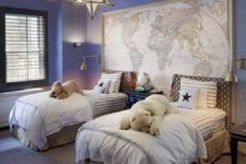 a nautical travel kids' room with a map, blue walls and a cool star chandelier will easily fit both girls and boys