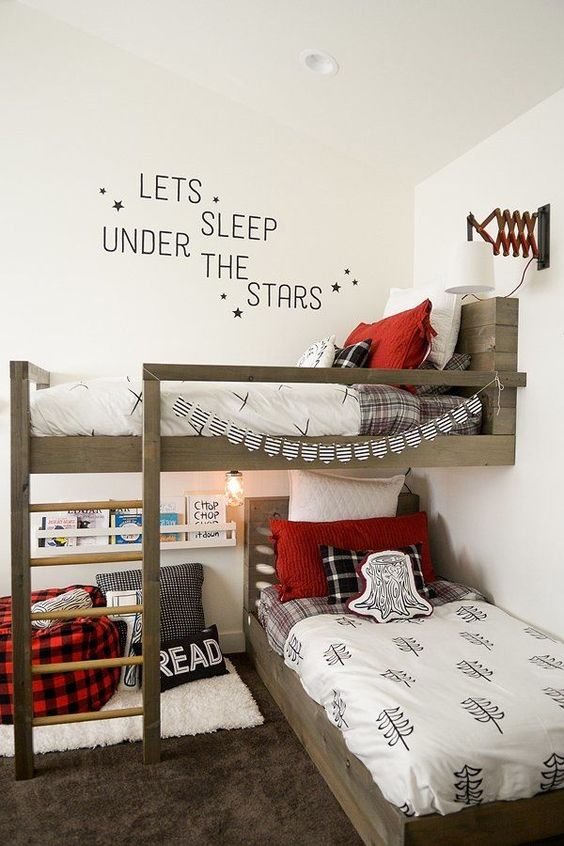 a shared lumbermen inspired kid's bedroom done in black, red and white with much light colored wood