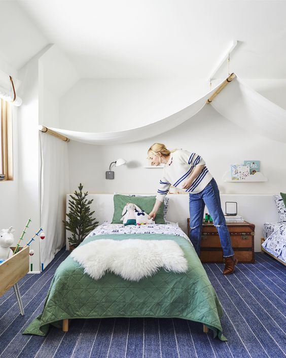 an adventure themed shared kids' room will easily fit both boys and girls thanks to its neutral color scheme