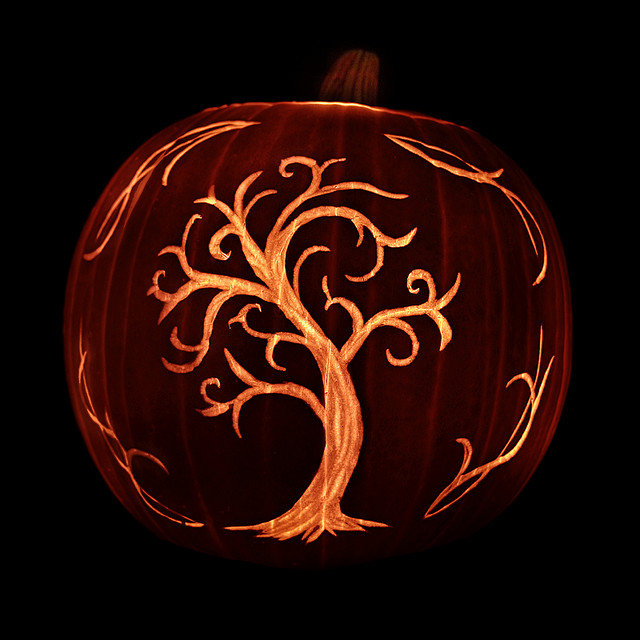 Tree carved on a pumpkin isn't spooky but looks great.