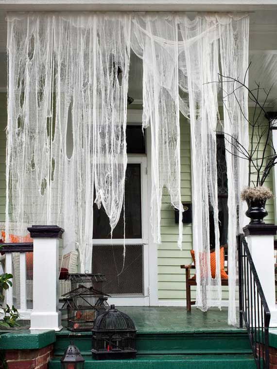 these spiderwebs are easy and inexpensive to make so dont hesitate to use this - Halloween Outdoor Decoration
