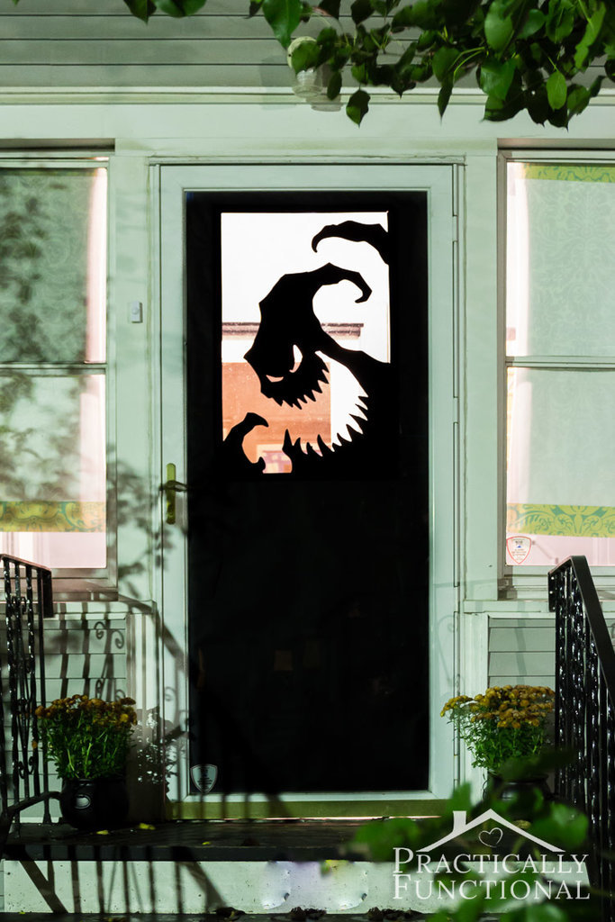 your doorway is an easy spot to decorate even with a single black paper sheet - Easy Halloween Decorating Ideas