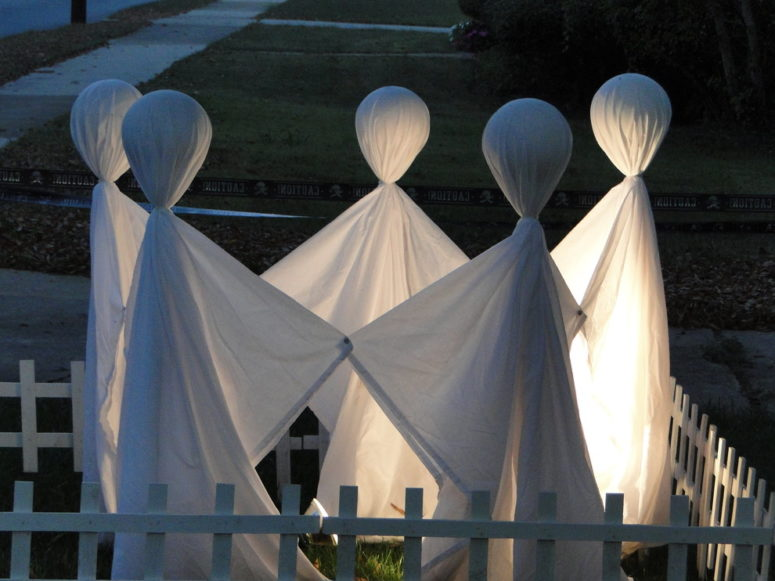a bunch of old white sheets could easily be turned into nice halloween ghost costumes or - Homemade Outdoor Halloween Decorations