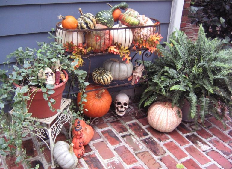 Mixing fall leaves, pumpkins, gourds and Indian corn works great for Fall decorations. Adding several skulls would turn suck display into a Halloween one. A bunch of tea lights would add a spooky vibe on Halloween night.