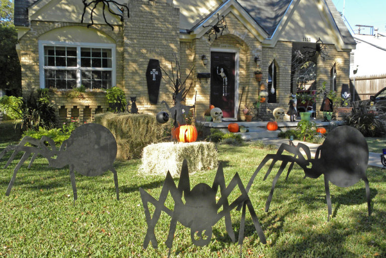 print a bunch of spider silhouettes and cut them from a plywood sheet next - Scary Halloween Yard Decorating Ideas