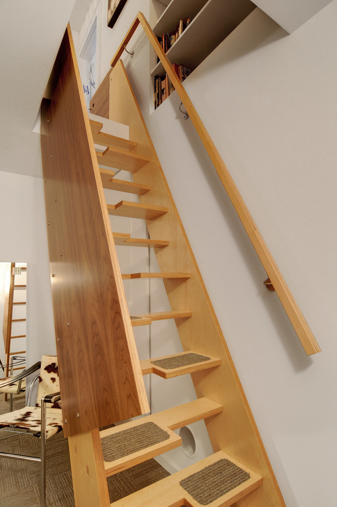 Small pieces of carpet would make such stairs more safe.