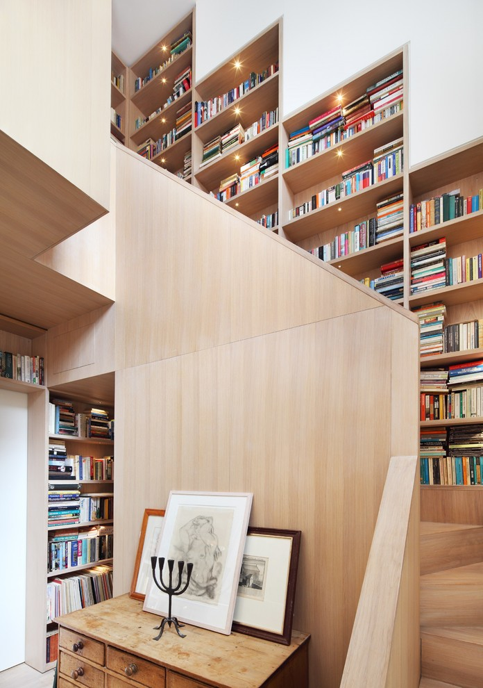 Staircase is a great place to organize additional book storage.
