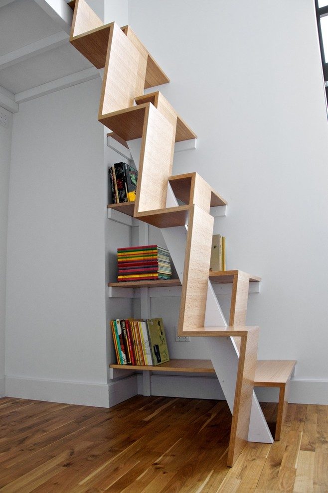 These modern and creative stairs are safe to climb and spatially efficient. The ope sides provide grip locations. The geometric design looks quite interesting and minimal. (nC2 architecture llc)