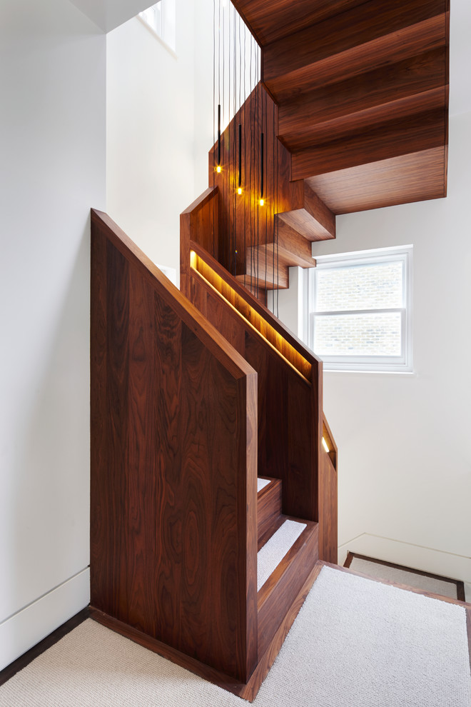 Even a compact staircase could be quite stylish and beautiful if it's made of wood. (Fraher Architects)