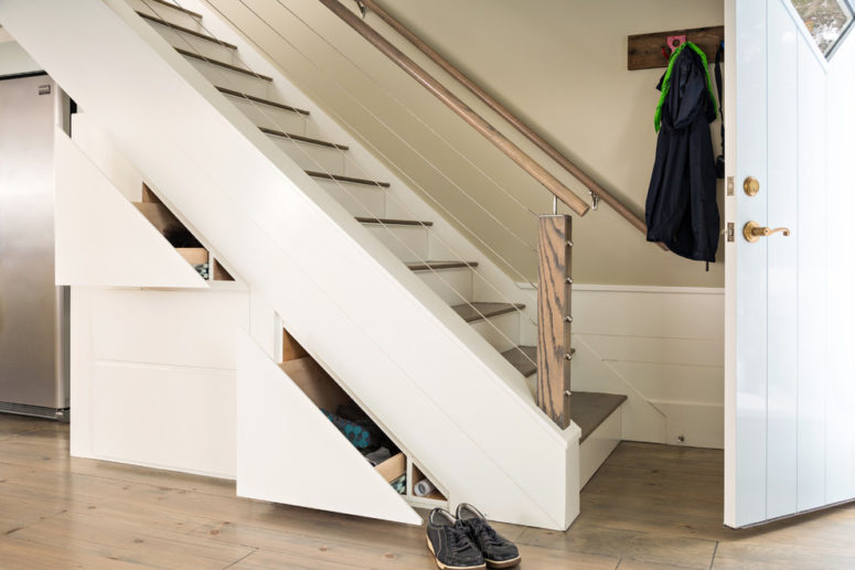 Space under the stairs could be used to store your shoes or even install a fridge there. (b Architecture Studio)