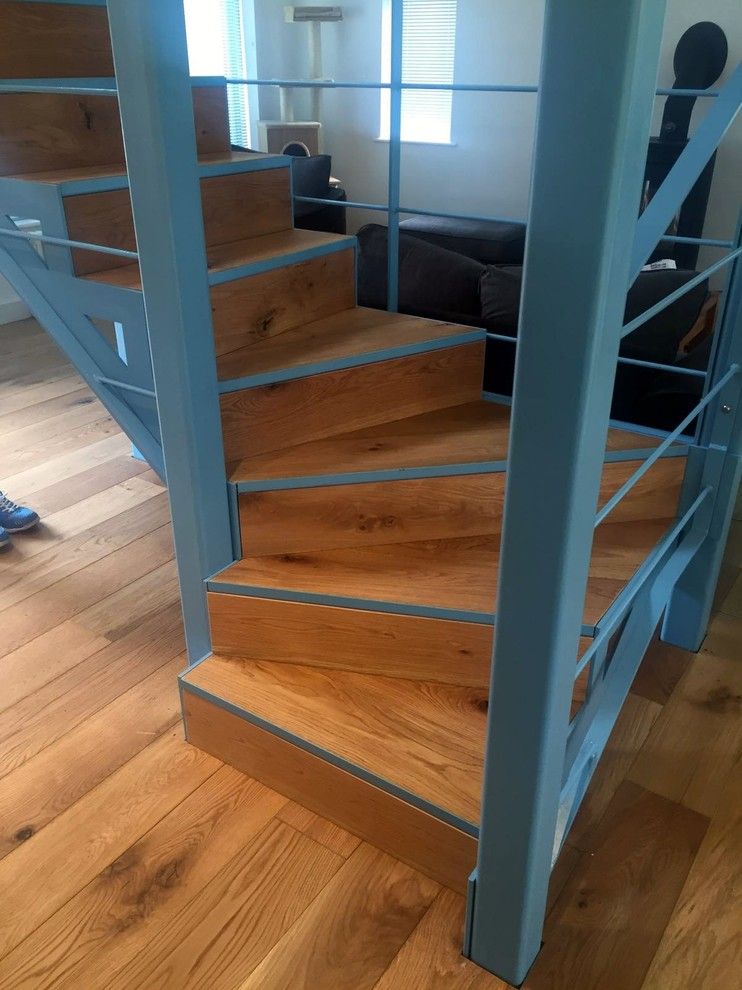 This compact staircase is made of steel and wood. Light blue looks good in a mix with natural wood. (Elysion Ltd)