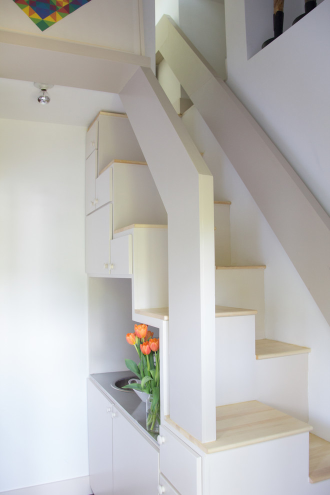 A Compact Ladder And A Trapdoor Designed In Minimalist Style Provide Access  To The Attic.
