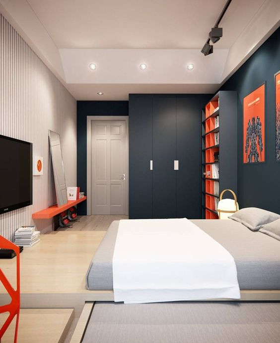 a clean minimalist or contemporary teenage bedroom with charcoal walls, a striped one, a platform bed, bright red touches