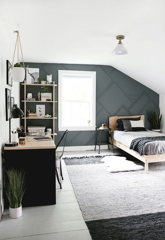 a contemporary teen bedroom with a 3D graphic wall, a black desk, a monochromatic rug and wooden furniture