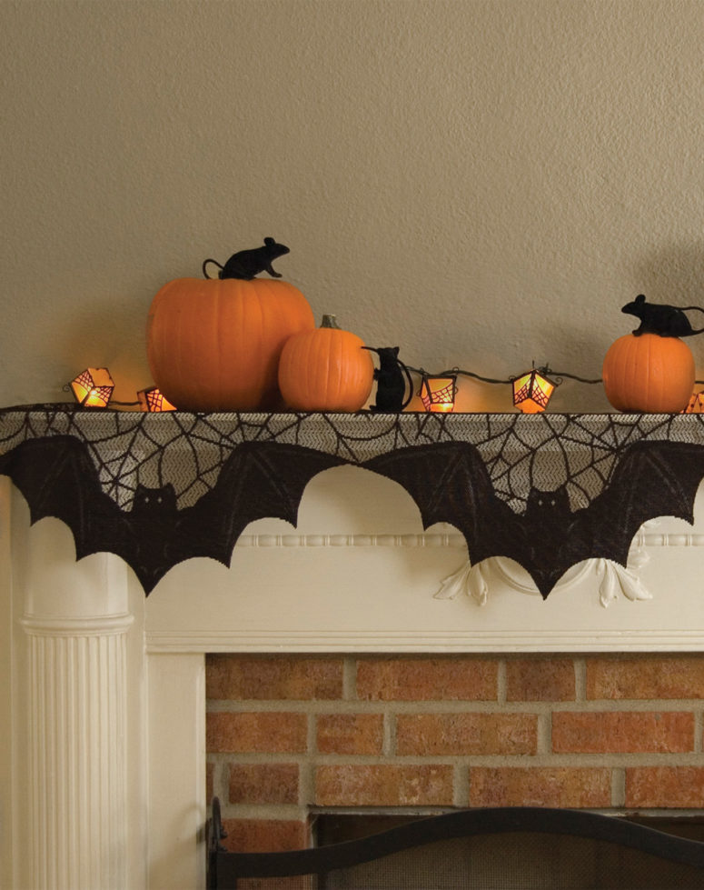 Mice playing among the pumpkins looks great with bat/spider themed mantle scarf.