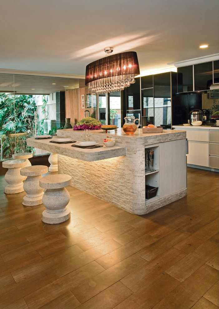 Marble strip mosaics looks gorgeous on this kitchen island and breakfast corner with lighting looks quite original
