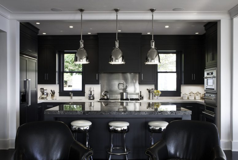 bold dark kitchen deisgn with black cabinetry and white countertops looks well combined with a island with a natural stone coutnertop