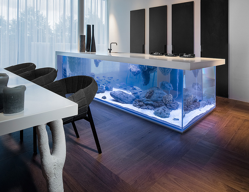could you imagine that a kitchen island could have an aquarium inside it