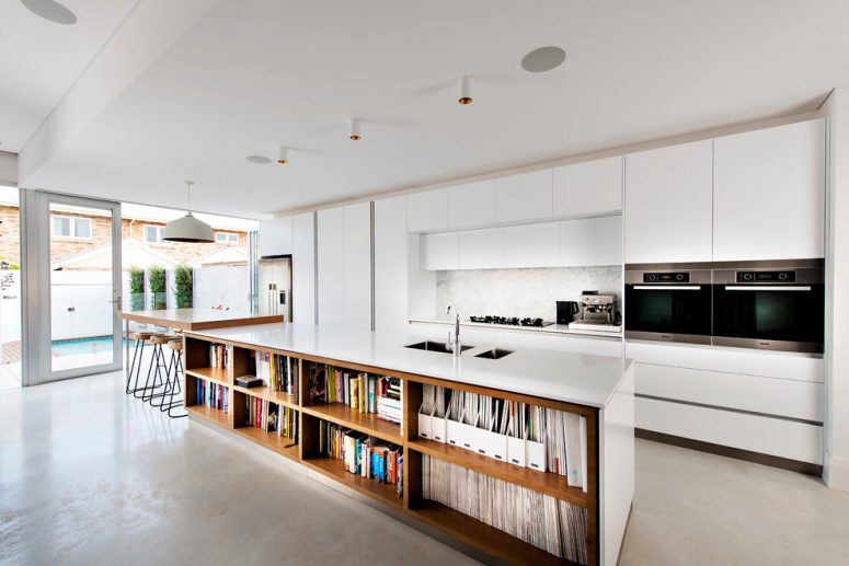 nice How To Design A Kitchen Island #8: modern kitchen island could provide enough storage space for cookbooks and  food magazines