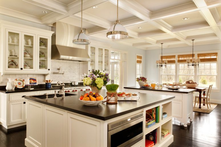 two traditional kitchen islands provide lots of storage and space for a built-in oven