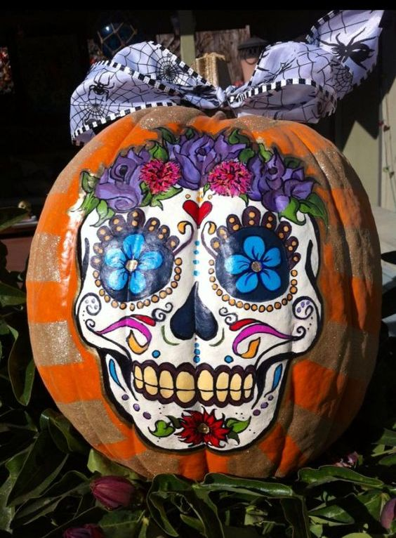 a colorful sugar skull Halloween pumpkin is a creative idea for those who don't want to carve but have good painting skills
