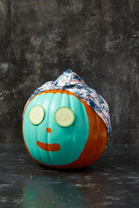 a funny no carved Halloween pumpkin with a face mask, cucumber slices and a head wrap is a lovely and cute idea