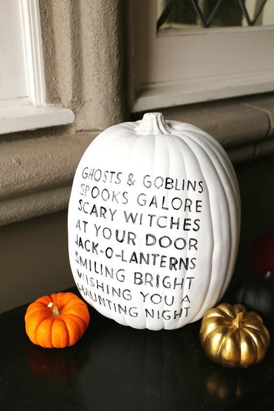 a white pumpkin decorated with a sharpie - with a cute rhyme inspried by Halloween is a simple and lovely idea