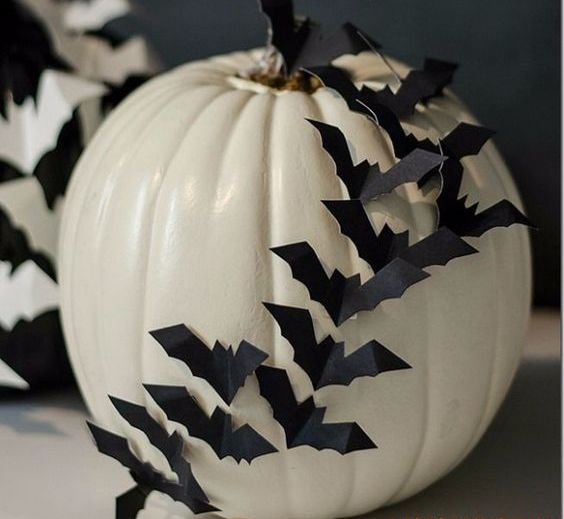 a white pumpkin decorated with black paper bats is a stylish idea for Halloween and will make your absolutely happy with how easy it is to make it