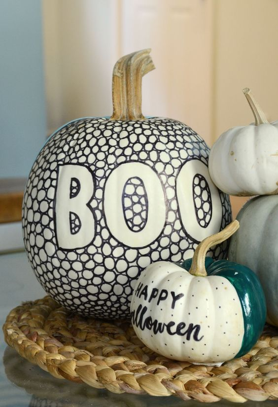 cool white pumpkins decorated with sharpies and with bright paint are amazing for Halloween and look chic