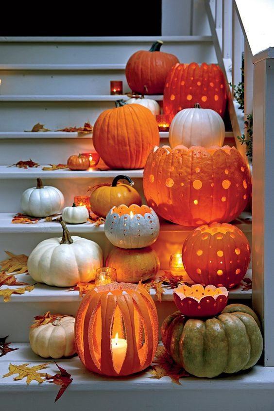 pumpkins carved in beautiful ways are beautiful and catchy Halloween candle lanterns and can decorate both indoor and outdoor spaces
