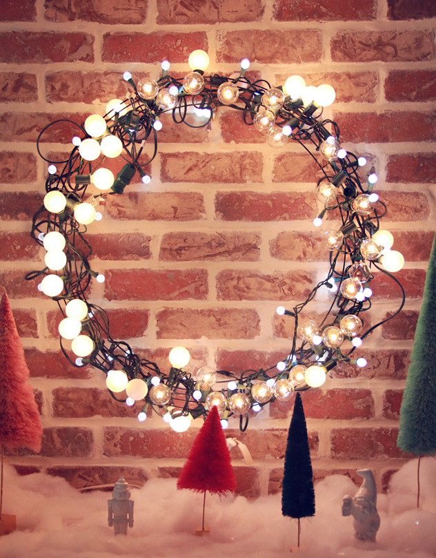 Light string Christmas wreath is a great idea to make your front door even more welcoming.