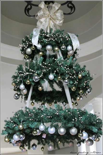 You can hang a wreath like a chandelier. If you combine several of them they'd look like a Christmas tree.