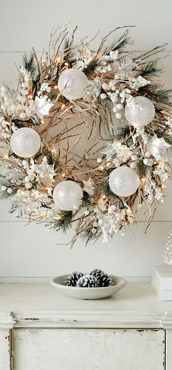 This white Christmas wreath is perfect for those who love Scandinavian decor style.