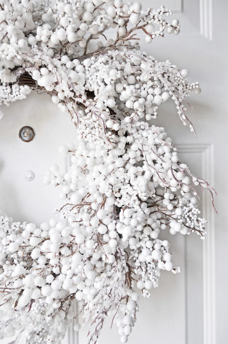 White wreath looks amazing on a white front door.