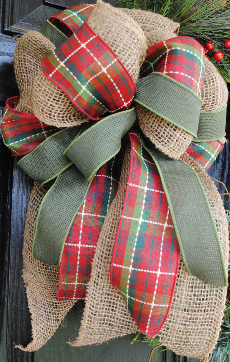 Mixing burlap with evergreen pine, cranberries and plaid ribbon is a great idea for a DIY rustic, natural-looking Christmas wreath.