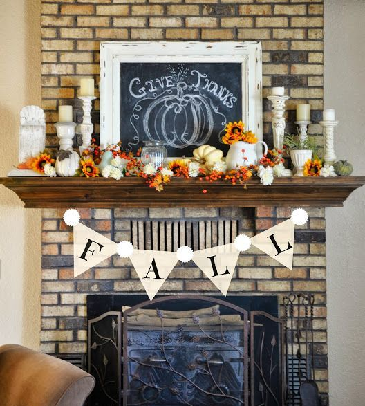 a bold vintage Thanksgiving mantel with berries, pumpkins and blooms   all faux ones, candles and a chalkboard sign