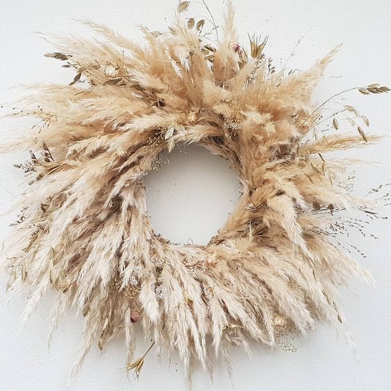 a lovely pampas grass wreath with some additional grass is a lovely and pretty solution for a fall or Thanksgiving celebration