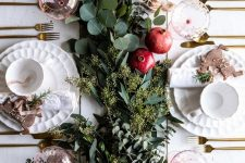 a lush greenery runner and some ripe pomegranates will make your tablescape ultimately fall chic and Thanksgiving-ready