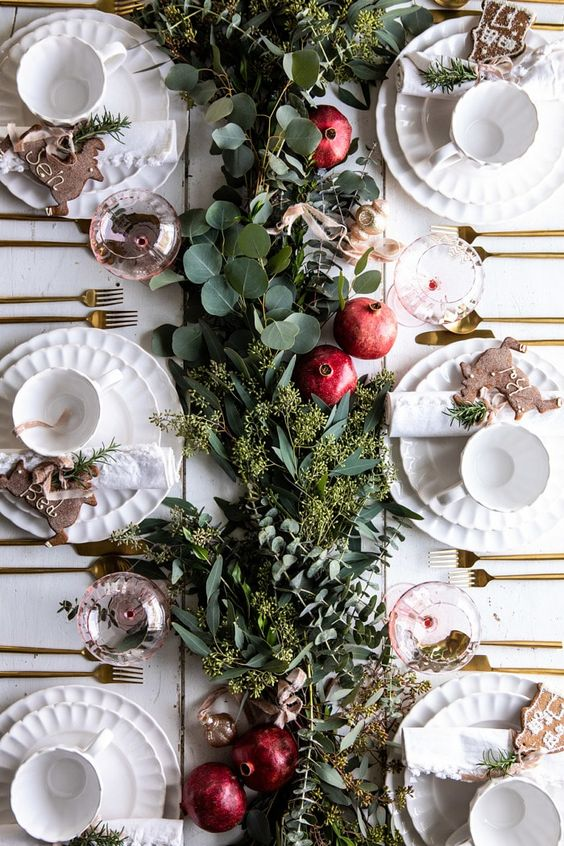 a lush greenery runner and some ripe pomegranates will make your tablescape ultimately fall chic and Thanksgiving ready