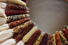 a cool rustic wreath made of corn cobs