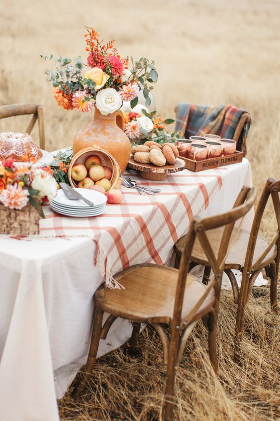 apples in a woven basket, bright blooms, fresh donuts and a bundt cake for a lovely Thanksgiving tablescape