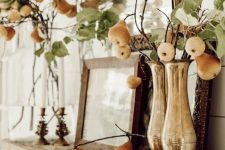 beautiful greenery arrangements with pears and apples and candles will make your mantel ultimately beautiful and cozy