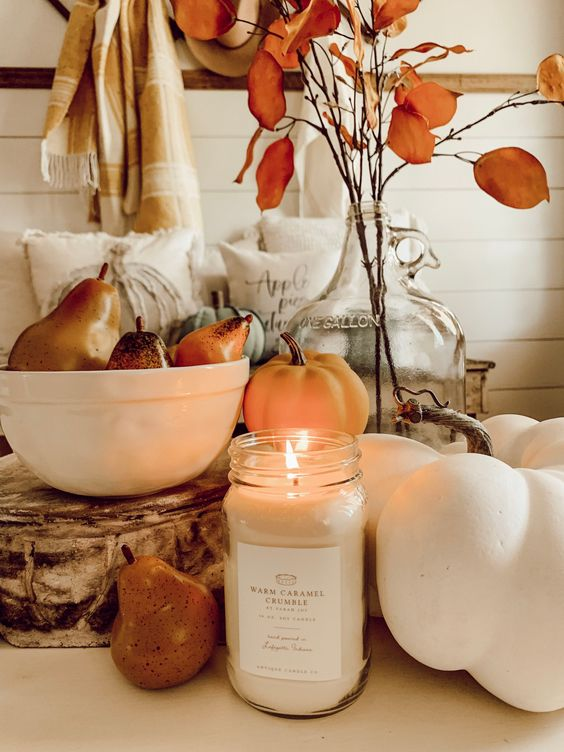 faux veggies, a candle and some dried blooms for beautiful and all-natural fall decor