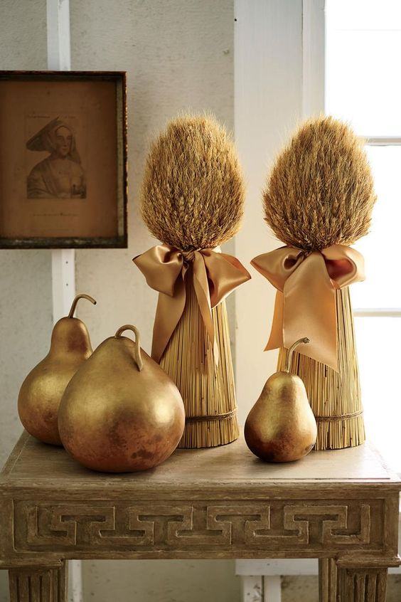 gilded pears and wheat bundles with silk bows are adorable rustic decor for fall or Thanksgiving
