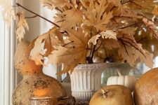 natural pumpkins and gourds, candles and fall leaves are amazing for fall and Thanksgiving decor