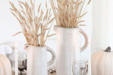 white porcelain jugs with wheat and white pumpkins for a pretty rustic tablescape – a fall or a Thanksgving one