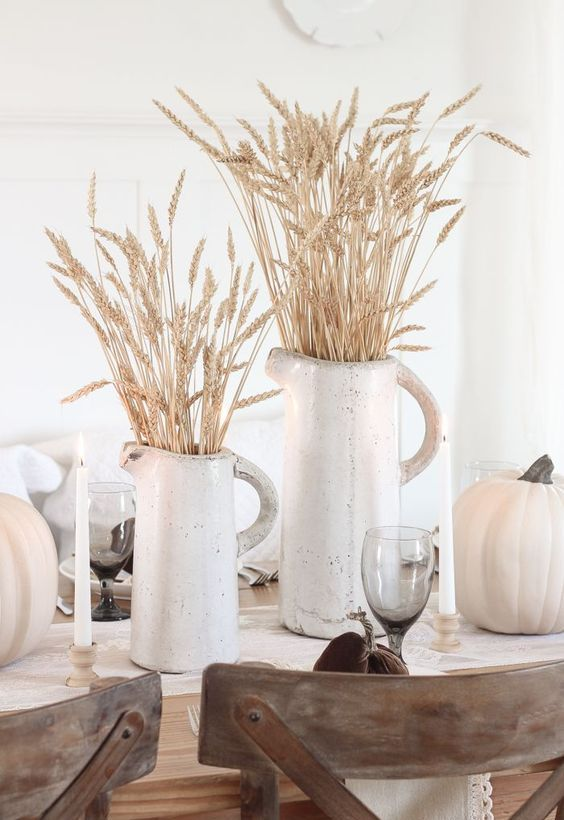 white porcelain jugs with wheat and white pumpkins for a pretty rustic tablescape - a fall or a Thanksgving one