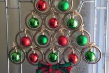 a creative Christmas tree of jar lids, green and red Christmas ornamerns and a plaid bow